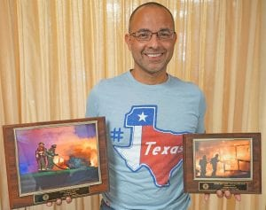 """Pleasanton volunteer firefighter and photographer, J Xavier Garcia received """"Best in Show"""" and second place for two of his fire photos at a fire convention in Longview. NOEL WILKERSON HOLMES 