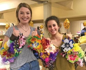 Shelby Henson and Mackenzie Pilgrim with the blossoms they made for Brooke's Blossoms. TAMMY HENSON | COURTESY PHOTO