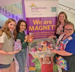 On July 16, Brooke's Blossoms were donated to children at The Children's Hospital of San Antonio. Pictured, from left, are Courtney Henson, Mackenzie Pilgrim, Shelby Henson and Jessica, a Child Life Specialist at the hospital. BETH WICKERSHAM | COURTESY PHOTO
