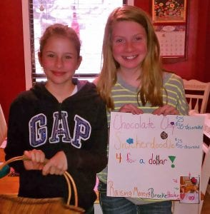 Mackenzie and Shelby in 5th grade selling snickerdoodles and chocolate chip cookies to raise funds for Brooke. TAMMY HENSON | COURTESY PHOTO
