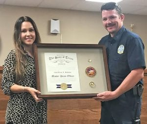 Poteet Chief of Police Bruce Hickman recently attained the rank of Master Police Officer. Hickman, shown with his wife, Jennifer, has 15 years in law enforcement, in many different capacities. He spent 12 years with the Atascosa County Sheriff's Department and became Chief in Poteet in 2015, after serving several years on the force. In order to obtain this certification, Hickman has completed 2,400 hours of training. DIANA GUTHRIE | PLEASANTON EXPRESS