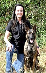 """Sponsored in part by San Miguel Electric Cooperative, the San Antonio Zoo's Center for Conservation and Research is helping the Texas horned lizard to make a comeback in central Texas by using """"sniffer dogs"""" like this Dutch Shepherd Gren – shown here with her trainer Chris – monitor and detect this beloved reptile in its natural habitat. COURTESY PHOTO 