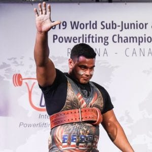 Jourdanton's Enrique Lugo Salutes the crowd at the 2019 World Junior Powerlifting Championship in Canada. INTERNATIONAL POWERLIFTING FEDERATION | COURTESY PHOTO