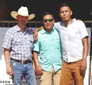 Pleasanton Young Farmers Rodeo was held August 16 and 17. Pictured is Clint Parker with the 1st place winners, Edwin Martinez and Cory Martinez. COURTESY PHOTO