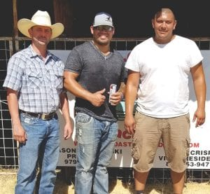 Pleasanton Young Farmers Rodeo was held August 16 and 17. Pictured is Clint Parker with the 2nd place winners, Jarrod Martinez and Jose Rodriguez. COURTESY PHOTO