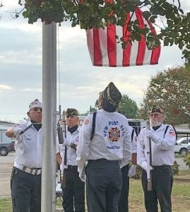 Poteet VFW Post 6970 raise the flag to half staff during the 9-11 ceremony Wednesday morning. NOEL WILKERSON HOLMES | PLEASANTON EXPRESS