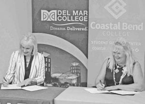 Lenora Keas (left), Vice President of Workforce Development and Strategic Initiatives at Del Mar College, and Coastal Bend College Interim President Dr. Carry DeAtley sign the CDL Training agreement. LEON ZABAVA | PLEASANTON EXPRESS