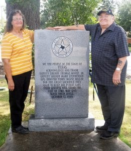 Debbie and Danny May, stepfather of Deputy Sheriff Thomas Monse Jr., stand alongside the memorial in downtown Pleasanton. It thanks and honors Monse, Deputy Sheriff Mark Stephenson and DPS Trooper Terry Miller. LISA LUNA   PLEASANTON EXPRESS