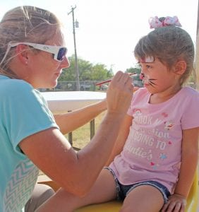 AnaLynn Tijerina gets her face painted. REBECCA PESQUEDA | PLEASANTON EXPRESS