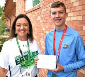 Pleasanton High School student Robert Rutherford received notification recently that he received recognition as a Commended Student from the National Merit Scholarship Corporation. He is pictured with PHS Principal Twila M. Guajardo. KELSIE LOZANO | COURTESY PHOTO