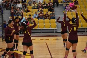 The Charlotte Trojanettes celebrate a point in their win over Ben Bolt. MARGARET GALLEGOS   PLEASANTON EXPRESS