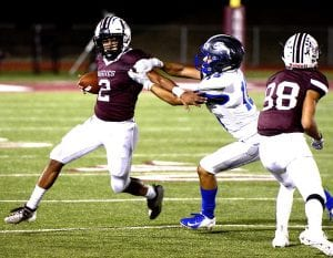 Poteet's Eric Treviño tries to evade a Natalia tackler on Sept. 27. SAM FOWLER | PLEASANTON EXPRESS