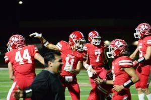 The Jourdanton Indians celebrate after recovering a fumble against Marion in a 35-14 win. SAM FOWLER | PLEASANTON EXPRESS