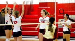 The Jourdanton Squaws celebrate a point off a kill from Sydney Morneau (13) against Cotulla on Wednesday, Oct. 9. The win moved the Squaws to 5-0 in District 30-3A. SAM FOWLER | PLEASANTON EXPRESS