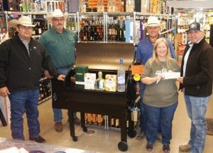 The Shot Glass/The Other Shot Glass held a raffle drawing, with proceeds benefitting the Atascosa County Law Enforcement Officer's Association (ACLEOA). Sharon LaGrange, owner of The Shot Glass/The Other Shot Glass, is pictured presenting a donation of $5,340 to Lt. Max Peralta of the Atascosa County Sheriff's Office. Peralta is also president of the ACLEOA. They are joined by Sgt. Jesse Martinez of the Atascosa County Sheriff's Office and ACLEOA director; Atascosa County Constable Cregg Thompson, (Pct. 3) and ACLEOA director; and Atascosa County Commissioner Mark Gillespie, (Pct. 1). LISA LUNA | PLEASANTON EXPRESS