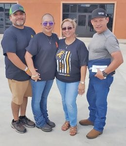 The parents of Jocelyn Lopez, Jocivus and Rachel Lopez (left) pictured with Amanda and Rick Luna, organizers of the Jocelyn Strong BBQ Fundraiser. SONYA ORTIZ   COURTESY PHOTO