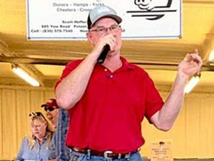 Owner, Scott Heffernan speaking at the 10th annual pig sale. COURTESY PHOTO