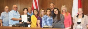 """The staff at Safer Path Family Violence Shelter attended the Oct. 21 Jourdanton council meeting, as Mayor Robert """"Doc"""" Williams proclaimed Domestic Violence Awareness Month. Pictured left to right are: council member Jack R. Harrison, Mayor Williams, Andrea Rathmell- Safer Path Outreach Coordinator, council member Chester Gonzales, Marissa Alvarez- Safer Path Volunteer Coordinator, Imelda Gomez- Safer Path Case Manager, Stephanie Martinez- Safer Path Advocate, Jesus M. Oliva- Safer Path BIP Program Director, Adriana Alvarado- Safer Path Advocate, council member Karen Pesek and council member Johnetta """"Johnnie"""" Goetzel. LISA LUNA 