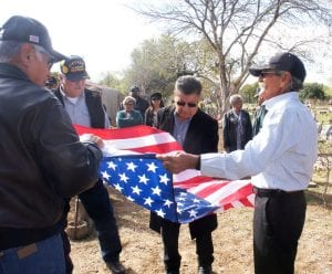 """Family members and classmates of Sgt. Moises Herrera Jr. attend a flagraising ceremony at San Ysidro Cemetery in Pleasanton. Pictured in the foreground, left to right are: Joe Rodriguez, Joe """"Tony"""" Garcia, Rudy Herrera (Moises' brother) and Roger Romero (Moises' cousin). LISA LUNA   PLEASANTON EXPRESS"""