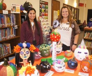 Pleasanton Elementary Librarian Margaret Martinez (at left) and Principal Donisha Miller stand among just a small portion of the entries in the Pumpkin Decorating Contest. There were over 270 entries! LISA LUNA | PLEASANTON EXPRESS