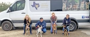 "Last Tuesday, the four remaining ""West Texas 7"" dogs set off on their final journey to forever homes with Texas Chihuahua Rescue to Washington state. Pictured, from left, are Caron Tuttle with Gurl, David Aguilar with Sutton, Brenda Gibbon with Whitney and Eydie Groenke with Kimble. REBECCA PESQUEDA 