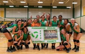The Pleasanton Lady Eagles pose with their bi-district championship banner after knocking off Devine. J GARCIA | COURTESY PHOTO