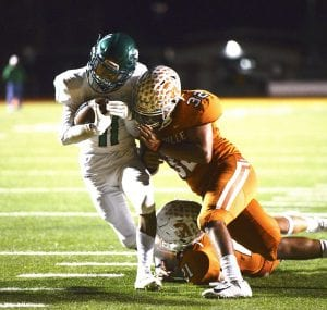 Pleasanton's Alonzo Duran (11) fights off a tackle for a touchdown against Beeville on Friday SAM FOWLER | PLEASANTON EXPRESS