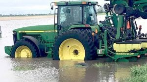 Tractor in a flooded field