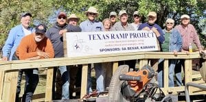 Participating in the Texas Ramp Project (TRP), left to right, are TRP, TRP, TRP, Craig Dowdy, TRP, Lois Bettis, Lee Ricks, Jr., Leonard Bettis, Lee Ricks III, James Warnken, Cheryl Ratcliff, Rotary President David Ratcliff. Ramp was built at the Bettis residence on Dugosh Road. COURTESY PHOTO