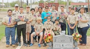Boy Scouts placing flags on veteran's graves at San Ysidro Cemetery on Sunday, November 10. Pictured above back row left to right from Boy Scouts Troop 194 are Paul Macmanus, Scoutmaster, Wesley Maspero, Blaine Macmanus, Eagle Scout, and Cole Hannah. Middle row left to right are Augustin De La Torre, Eagle Scout, Connor Below, Tex Anderson, Alberto De La Torre, Wanish Tortes-McGinnis, Jairo Ortiz, William Chancellor, Zander Temple, ASPL, Carter McMain, and Joett Morrison, Asst. Scoutmaster and Treasurer. Front row sitting left to right are Seth Macmanus, SPL, Garrett Mills, J.R. Lopez. JOETT MORRISON   COURTESY PHOTO
