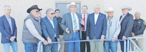 During the ribbon cutting at the expanded county jail, from left, are Eric Cohen with Butler Cohen; Commissioner Kennard Riley, Pct. 4; Perry Rabke, architect; Commissioner Stuart Knowlton, Pct. 2; Captain Martin Gonzales, Jail Administrator; Atascosa County Sheriff David Soward; Wayne Gondeck, architect; Atascosa County Judge Bob Hurley; Commissioner Mark Gillespie, Pct. 1; Former Commissioner Bill Carroll and Jail Lt. Mike Benavidez. LEON ZABAVA | PLEASANTON EXPRESS