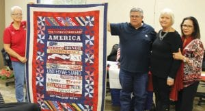 Pictured at the Quilt of Honor presentation are, left to right: Margie Williams, member of the Quilt of Honor organization; Robert Morantes, Quilt of Honor recipient; Pat Nunley, Pleasanton Woman's Club member who made the quilt and Mrs. Natalia Morantes. LEON ZABAVA | PLEASANTON EXPRESS