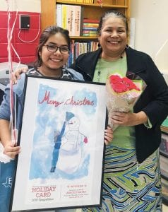 Aracely Gaitan's holiday card design was chosen as the winner for the middle school level in a holiday card contest held by Region 20. She is pictured with Charlotte sixth grade art teacher, Deborah Napier. REGION 20 EDUCATION SERVICE CENTER | COURTESY PHOTOS