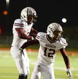 Poteet's Eric Treviño (2) and Ernest Davila (12) celebrate a touchdown in their Bi-District meeting with Wimberley. SAM FOWLER | PLEASANTON EXPRESS