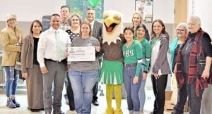 Pictured, from left, are Stephanie Brown, Margie Mendez, Paul Bernal, Mark Tullos, Sara Mann, Lauri Kelley, Dr. Matthew Mann, Big E, Noelani Guerrero, Heather Foster, Gabby Palacios, Twila Guajardo, Sue Brown and Dot Vrana. EMILY MANN | PLEASANTON EXPRESS