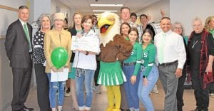 From left, are Dr. Matthew Mann, Sara Mann, Stephanie Brown, Heather Foster, Dawna Garvin, Big E, Margie Mendez, Mark Tullos, Noelani Guerrero, Gabby Palacios, Paul Bernal, Sue Brown and Dot Vrana. EMILY MANN | PLEASANTON EXPRESS