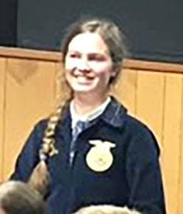 Sawyer Huggins introducing herself at the JISD Board of Trustees meeting. COURTESY PHOTO