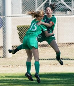 Lady Eagles Brylee Miller (15) and Delanee Olivarri celebrate a gamewinning goal in the 80th minute against Beeville in the semifinals of the Battle of the Brush Country. Miller scored the winning goal on an assist from Madelyn Bird. J GARCIA | COURTESY PHOTO