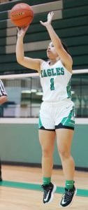 Baylee Bauer shoots a three-pointer for the Lady Eagles in their win over Poteet Friday night. J GARCIA | COURTESY PHOTO
