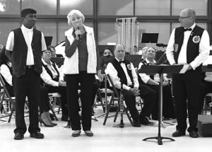 Fr. Prasanna Mese of St. Andrew's Catholic Church and Patsy Troell welcome director Toby Knight and the County Line Community Band at their 2018 Christmas concert. CHRISTELLE TROELL | PLEASANTON EXPRESS