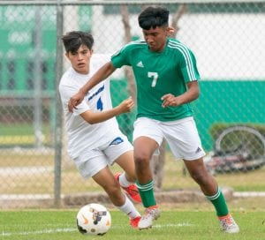 Silberio Banda (7) dribbles past a Santa Gertrudis defender during the Eagles' 7-0 win on Friday. J GARCIA | COURTESY PHOTO