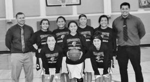 The Charlotte Trojanettes pose for a picture in the gym of Charlotte High School. MARGARET GALLEGOS | PLEASANTON EXPRESS