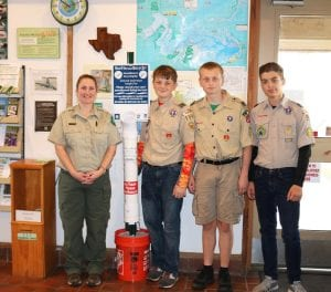 Boy scouts placing a Monofilament fishing line collection tube station at the headquarters of Choke Canyon State Park. Pictured above left to right are: Cara Bierschwale, Asst. Office Manager and Volunteer Coordinator at Choke Canyon State Park, Koal Schaub, Tex Anderson and Zander Temple.