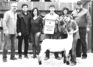 RESERVE GRAND CHAMPION LAMB Isabella Weiss of Jourdanton FFA, with her Reserve Grand Champion Lamb. Buyers were Primo's Feed & Supply and Price Chrysler Dodge Jeep Ram Dealership. Pictured, from left, are Bob Price, Zachary Price and Cheryl Price (Price Dodge Jeep Ram Dealership), Beidler Weiss with banner (brother), Isabella Weiss, Shirley Wiley (Primo's Feed & Supply) and Josh Powell (Primo's Feed & Supply). MEMORIES ON MAIN | COURTESY PHOTO