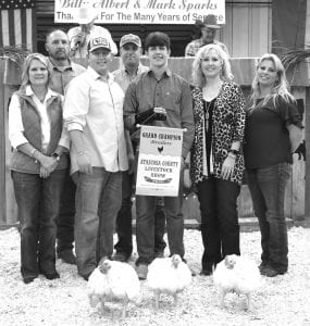 GRAND CHAMPION BROILERS From Jourdanton FFA, Randall Benton won Grand Champion Broilers, buying were, from left: Benita Muckleroy (First Commercial Bank), James Eanes (Glazers Beer & Beverages), John Olle (Statewide Claims Services), Chris Jenschke (Forage Specialties), Randall Benton (GC Broilers), Aubrey Smith (H-E-B) and Crissy Jenschke (Forage Specialties). MEMORIES ON MAIN | COURTESY PHOTO