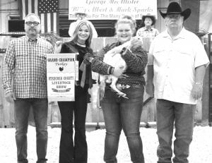 GRAND CHAMPION TURKEY Madison Lutz from Jourdanton FFA won Grand Champion Turkey with her Turkey Hen. Buying out all other buyers were Bob Price (Price Chrysler Dodge Jeep Ram Dealership) on far left and Belo Wiley (Primo's Feed & Supply) on far right. In the center, from left, are Allison Scerley holding the GC Turkey banner and GC Turkey winner Madison Lutz. MEMORIES ON MAIN | COURTESY PHOTO