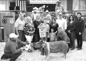RESERVE GRAND CHAMPION HOG From Pleasanton FFA, Bryndan Olle won Reserve Grand Champion Hog with his Class 8 Cross. Buyers were, from left: Michael Olle (Temper Septic Services), Zach Moseley (McClenny, Moseley & Associates), Darala Olla (Temper Septic Services), Erinn Walker (Tuttle Motor Company), Ralph Goode (Glazers Beer & Beverages), Ryann Krauskopf (Bar 80 Cattle), Evan Walker (Tuttle Motor Company), John Krauskopf (Bar 80), Aubrey Smith (H-E-B), CJ Rodriguez (Silver Eagle Distributors), Shirley Wiley (Wiley Lease Co.), John Olle (Statewide Claim Services), Blair Varnon (Bar 80), Josh Powell (Primo's Feed & Supply), Bob and Cheryl Price (Price Chevy), Chris Varnon (Bar 80 Cattle), Zachary Price (Lightning Fast Car Wash). Up front are Morgan Wagner (kneeling with water bottle), Kaydin Olle holding banner (brother), William Olle (brother), Krystle Olle (mom) and Bryndan Olle (kneeling). MEMORIES ON MAIN | COURTESY PHOTO