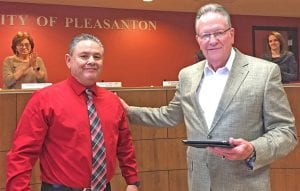 Pleasanton Mayor Travis Hall, right, congratulates City Manager Johnny Huizar on his appointment by Gov. Greg Abbott to serve on the Texas Municipal Retirement System's Board of Trustees. The board oversees the retirement system of eligible employees of more than 800 cities. He will be sworn into the position at the Feb. 20 council meeting by Senator Pete Flores. CHRISTELLE TROELL| PLEASANTON EXPRESS