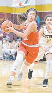 Vanessa Vacca (11) drives to the lane for Jourdanton against Cotulla on Feb. 7. The senior point guard led the way in scoring for the Squaws with 13 points SAM FOWLER | PLEASANTON EXPRESS