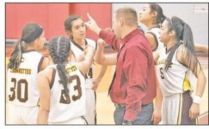 The Charlotte Trojanettes break out of the huddle against Winston on Feb. 4. MARGARET GALLEGOS | PLEASANTON EXPRESS